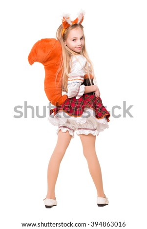 Nice little girl wearing like a squirrel showing her tail. Isolated on white