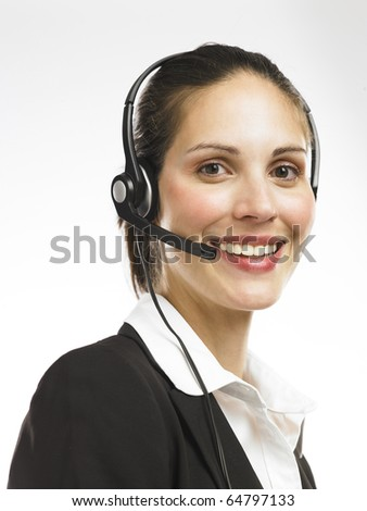 Nice looking telephone operator smiling - stock photo