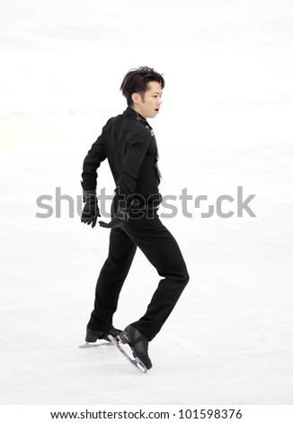 NICE - MARCH 31: Daisuke Takahashi of Japan skates during official practice at the ISU World Figure Skating Championships on March 31, 2012 in Nice, France - stock photo