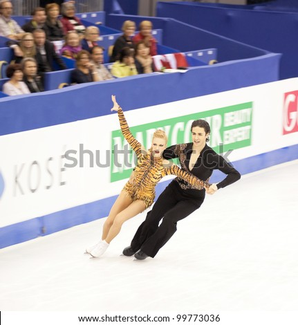 NICE - MARCH 28: Kaitlyn Weaver and Andrew Poje of Canada perform their short dance at the ISU World Figure Skating Championships held on March 28, 2012 in Nice, France - stock photo