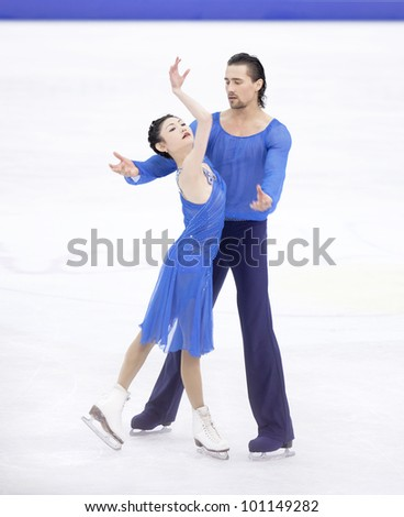 NICE - MARCH 30: Yuko Kavaguti and Alexander Smirnov of Russia perform their free skating at the ISU World Figure Skating Championships, held on March 30, 2012 in Nice, France - stock photo