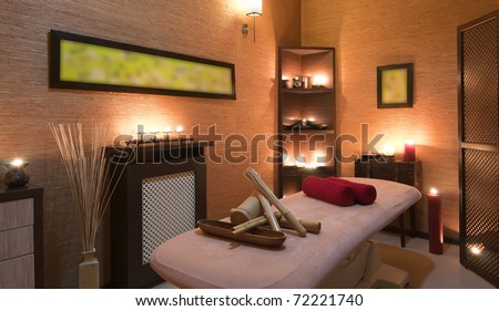 Nice massage room in spa saloon decorated with candles.
