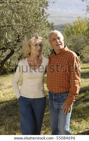 nice mature couple in the country - stock photo