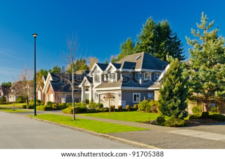 Nice neighborhood. A homes in suburbs in the north America - stock photo