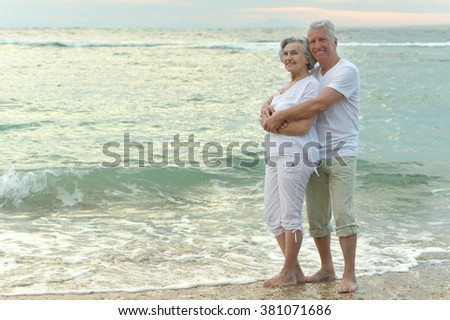 Nice old couple running on sea beach