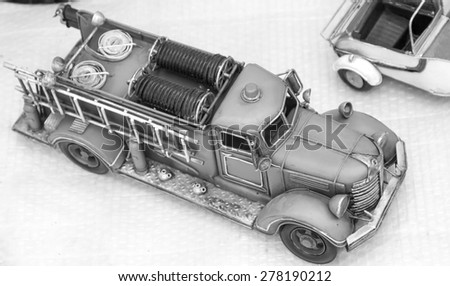 nice old toy fire truck in wood - stock photo
