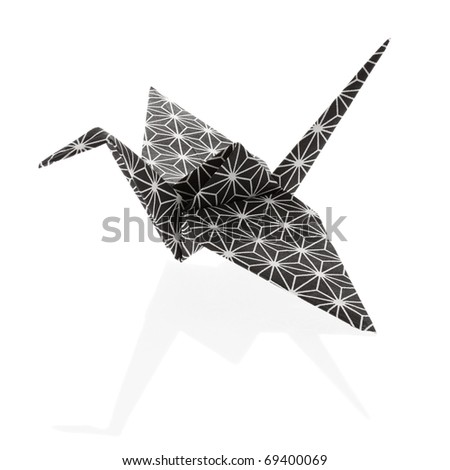 Nice Origami Crane, folded out of a rice paper with traditional japanese pattern. - stock photo