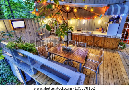 nice patio at a home in the woods - stock photo