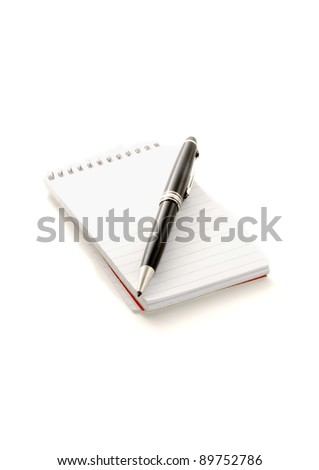 Nice pen over notepad - stock photo