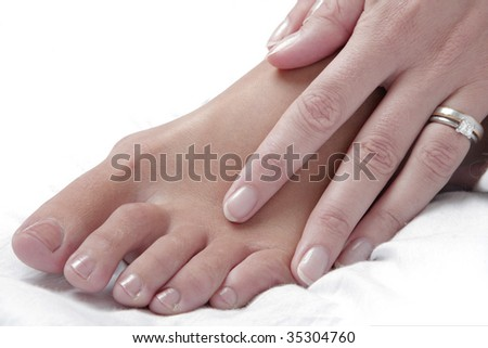 Nice photo of a womans foot and hand with a white background - stock photo