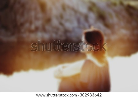 Nice picture of blurred woman at sunset - stock photo