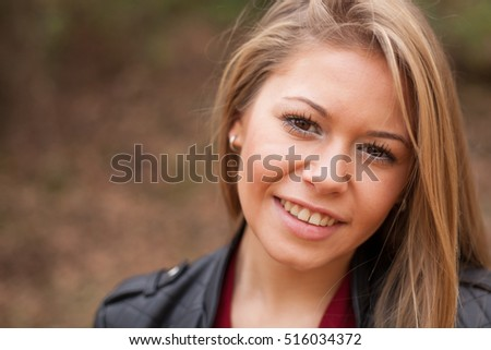 Nice portrait of blonde girl looking at camera