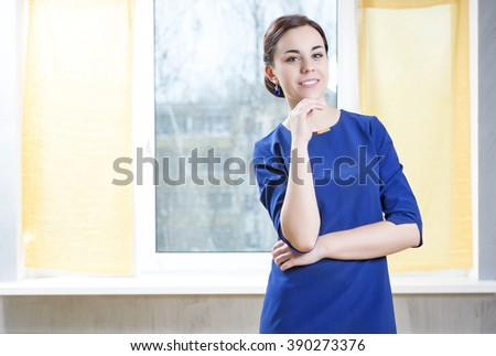 Nice Portrait of Sensual Woman in Elegant Blue Dress. Posing Indoors. Vertical Image Composition