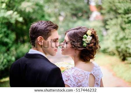 nice portrait of young and beautiful bride and groom