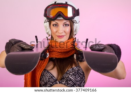 Nice pretty girl in lingerie with ski equipment - stock photo