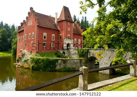 nice red castle near water lake - stock photo