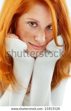 Nice redhead wearing white wool sweater - stock photo