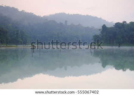 Nice reflection in the Kenyir Lake, Terengganu, Malaysia during a misty morning.