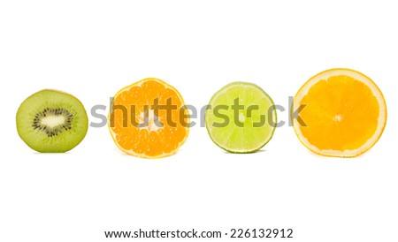Nice ripe and juicy kiwi, tangerine, lime and orange. Isolated on white. - stock photo