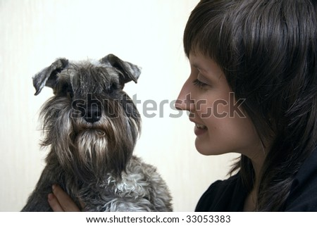 Nice schnauzer with its cute owner isolated on white - stock photo
