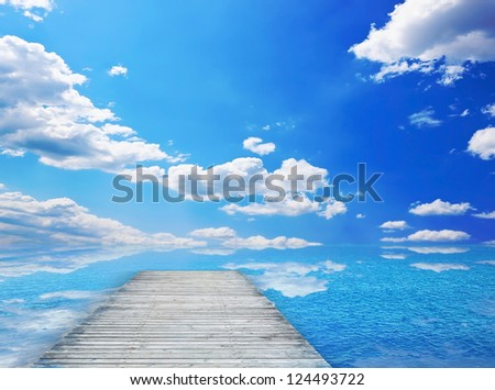 Nice sea and pier on sunny day - stock photo