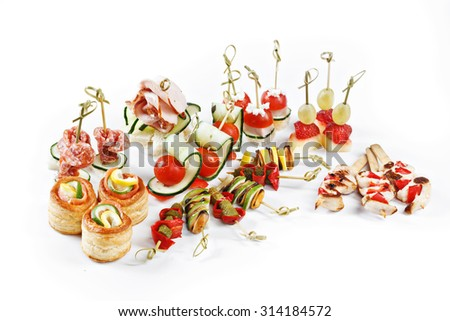 nice set of canapes for one person with vegetables, cheese, fruits, berries, salami, seafood, meat and decoration on white background studio isolated with space for text template - stock photo