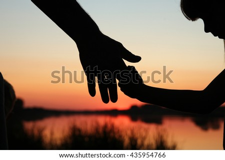 nice silhouette parent and child hands