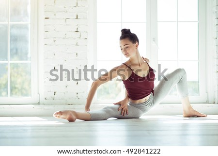 Nice slim woman practicing choreography