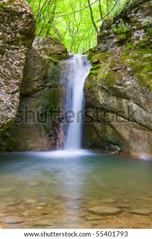 Nice small waterfall in forest - stock photo