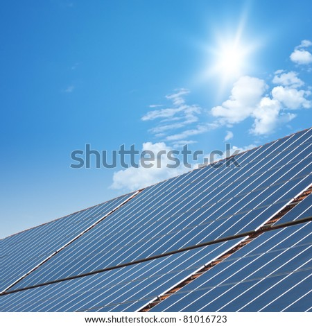 nice solar panels with blue sunny sky background - stock photo