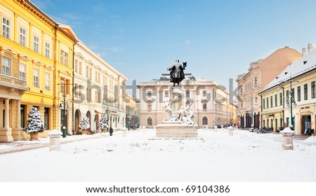 Nice square with statue at winter