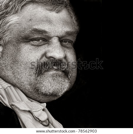Nice strong portrait Of a Cowboy up Close - stock photo