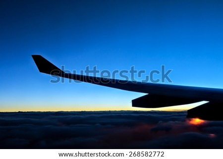 Nice sunrise view from airplane - stock photo