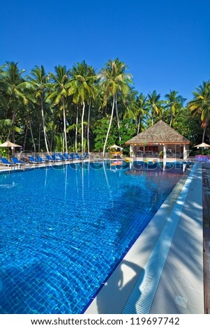 Nice swimming pool in a tropical hotel, Maldives - stock photo