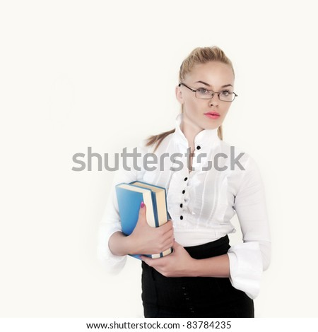 nice teacher holding books over white background - stock photo