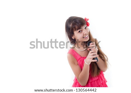 Nice teen girl with microphone, singing. smiling little girl in red dress. portrait of a happy little girl playing, isolated on white background. - stock photo