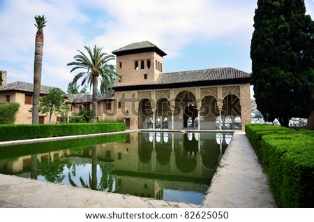 Nice view across a pool and garden in the famous Alhambra - stock photo