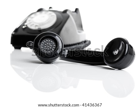Nice vintage telephone perfectly isolated on white background, focus is on the handset - stock photo