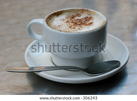 Nice warm cup of cappuccino - stock photo