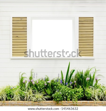 Nice white framed window with flowers - stock photo