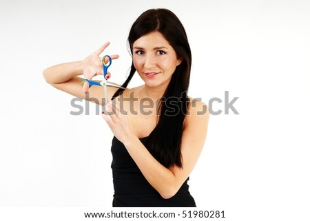 nice woman cutting her long dark hair