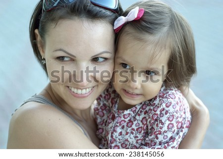 Nice woman with a daughter on a white background