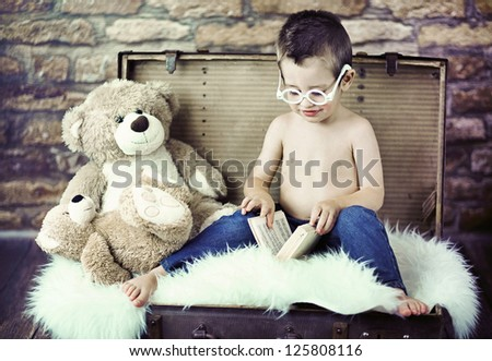Nice young boy reading a book - stock photo