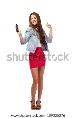 nice young woman posing with earphone in studio - stock photo