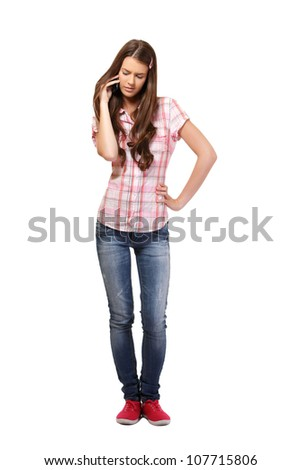 nice young woman speaking on cellphone, isolated on white - stock photo