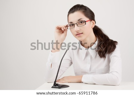 nice young woman with a microphone on a white background - stock photo