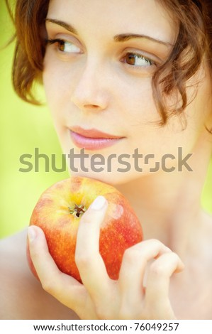 Nice young woman with red apple - stock photo