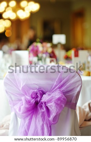 Nicely decorated chair at an event party or wedding - stock photo
