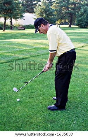 Nicely dressed male golfer on the links. - stock photo