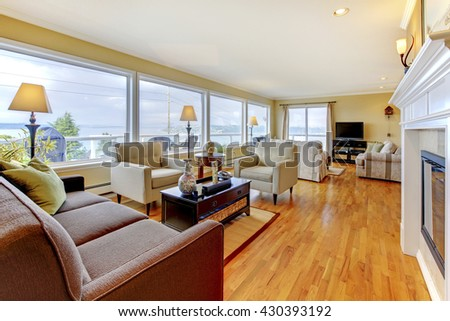 Nicely furnished living room with hardwood floor, beige walls and water view